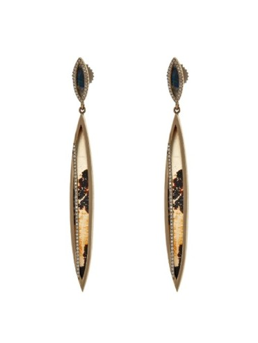 Most recently, Péan was named one of Fast Company's Most Creative People in Business 1000 in January 2014. (Diamond, agate, spectrolite and gold earrings)