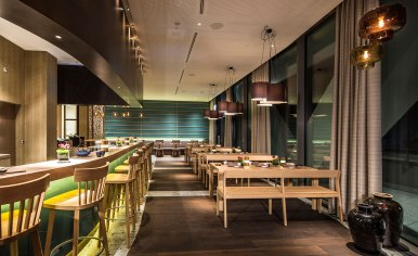 Guest facilities include the Studio Grigio, a fine-dining restaurant located on the top floor, alpine brasserie Capricorn (pictured), bar and lounge area Nuts & Co, as well as the Alpine Spa.