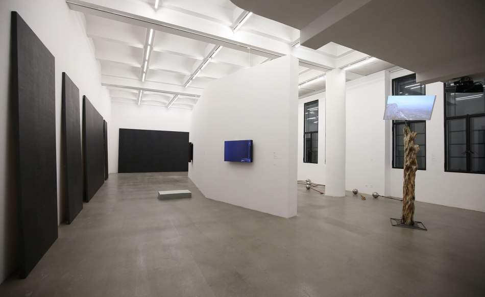 Pictured left: Maria Tanaguchi's imposing brick painting series, of which she states: 'the work is about investigating the structures for making art'