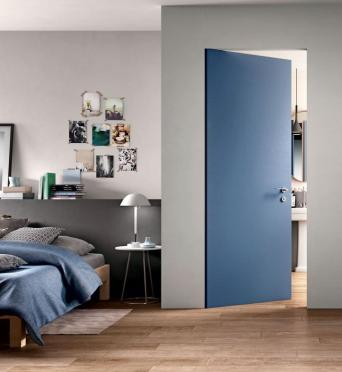 Ferrerolegno's new 'Fair Zero' features a flush frame and sash in an Ecorovere finish texture called Blue Dove. The brushing and varnishing open-pore process enhances the quality of the wood. ferrerolegnoporte.it