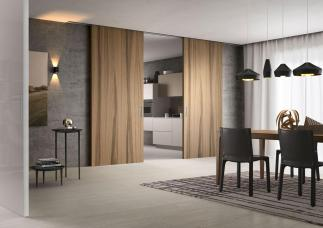 Lignum is a new wooden panel line by Ferrerolegno, the sliding door system is built on fixed panels, which allows one to customize the space. ferrerolegnoporte.it