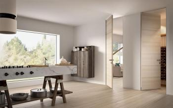 This is an interesting new proposal by Garofoli. The door panels are matched to the flooring, creating a seamless and open environment. In the photo, the door and flooring are designed in a customized Ice Oak finish by Garofoli. This particular door panel, is called the Biverso from the Filomuro series (which means the door is installed to open by push or pull). garofoli.com