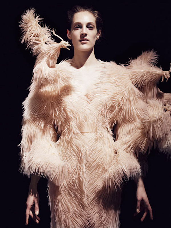 Iris van Herpen (Dutch, born 1984). Dress, fall/winter 2013–14. Silicon feather structure and moldings of bird heads on cotton base. Photograph by Jean-Baptiste Mondino