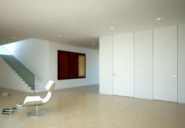 The RasoParete Panel System is highly customizable. Named a system rather than a door, this wall component acts as an interior space organizer due to its flexible shelving options. The panels and the posts can be pre-painted by the company or it can be facilitated on-site to match finishes, depending on the design needs. sistemirasoparete.it
