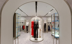 The designer's attention to detail extends to elegantly simple brushed steel clothes hangers and the spacious dressing rooms featuring soft backlit tulle-inspired steel mesh walls and retro-style microphones for summonsing assistance.