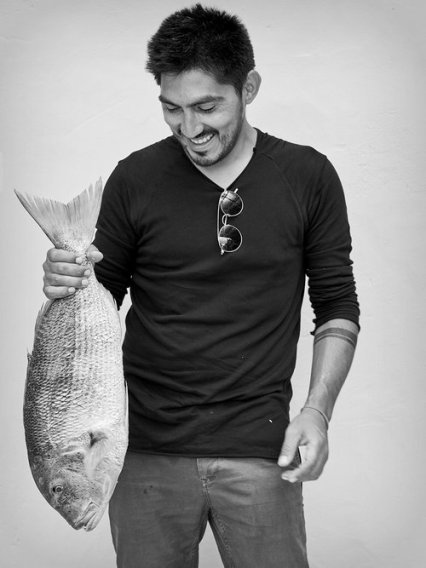 """""""I like to serve foods whole whenever possible. For us, the dream is that when somebody sees the fish, they eat it with their hands, because there's so much good stuff between the bones."""" — José Catrimán, Head Chef"""