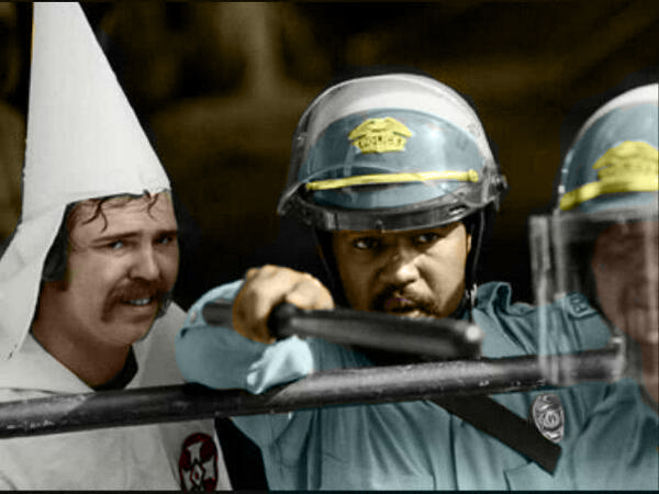 1983-e28093-austin-texas-this-policeman-protects-kkk-members-during-a-rally-as-protestors-were-closing-in-on-them