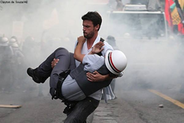 brazilian-protester-carrying-an-injured-officer-to-safety-sao-paulo-brazil-2012