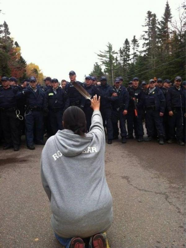 feather_to_police-ossie_michelin_aptn_reporter