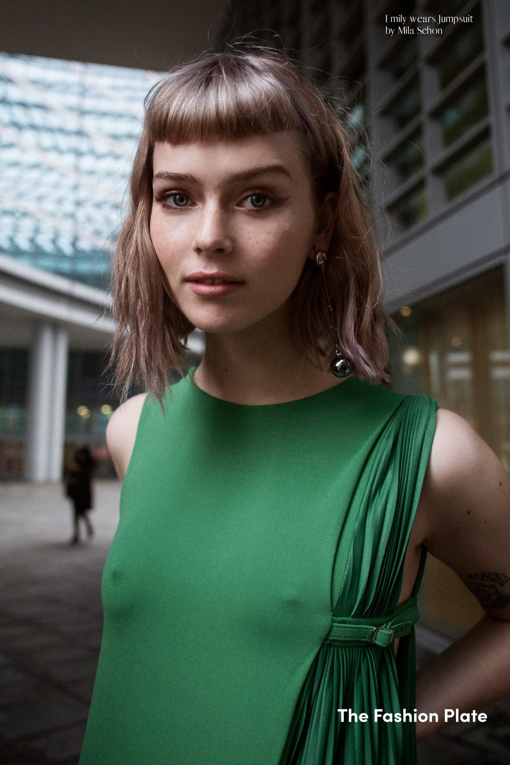 green jumpsuit close up