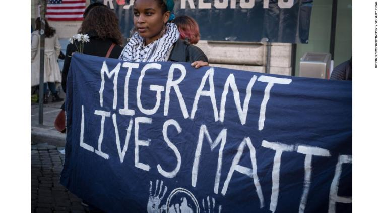 180120131334-02-rome-womens-march-signs---migrants-super-169