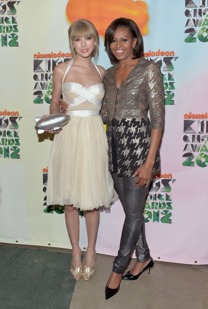 Former first lady Michelle Obama, in Wes Gordon, with Taylor Swift at the Nickelodeon 25th Annual Kids' Choice Awards.