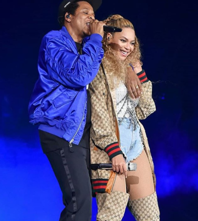 Beyonce in animal print catsuit and bomber jacket by Gucci.