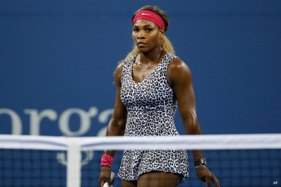 Serena Williams, of the United States, reacts after losing a game to Taylor Townsend, of the United States, during the opening round of the U.S. Open tennis tournament Tuesday, Aug. 26, 2014, in New York. (AP Photo/Jason DeCrow) ORG XMIT: USO631