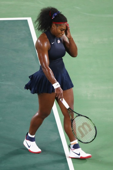 RIO DE JANEIRO, BRAZIL - AUGUST 09: Serena Williams of the United States reacts during a Women's Singles Third Round match against Elina Svitolina of Ukraine on Day 4 of the Rio 2016 Olympic Games at the Olympic Tennis Centre on August 9, 2016 in Rio de Janeiro, Brazil. (Photo by Clive Brunskill/Getty Images) ORG XMIT: 631389101 ORIG FILE ID: 587845218