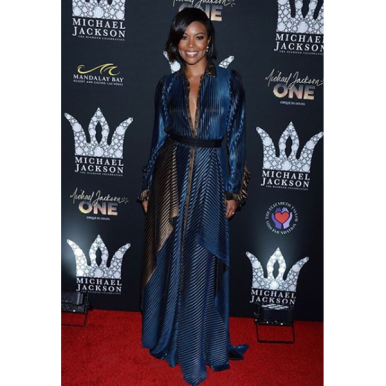 Gabriele Union in ablue and antique gold pleated shirt dressbyDora Abodi.