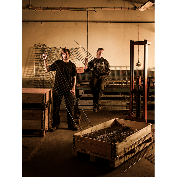 Swedish factory workers holding components of the String system. (photo: Bruno Ehrs)