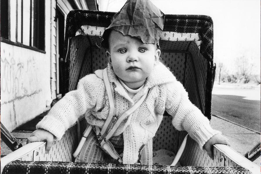 """Arlene Gottfried, """"Baby With Paper Bag on Head, Staten Island, 1974"""", copyright Arlene Gottfried. (photo: courtesy Galerie Bene Taschen)"""