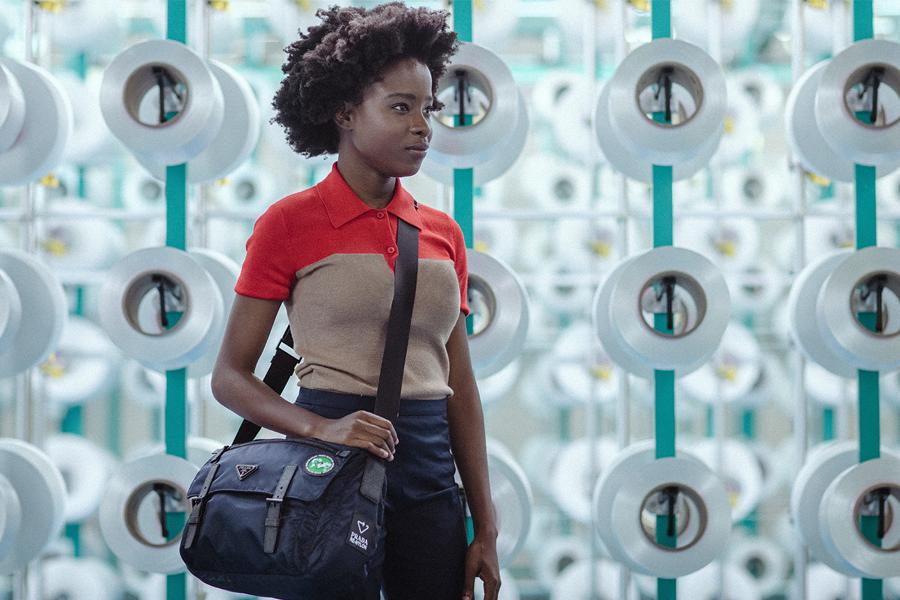 Prada reporter Amanda Gorman, the inaugural US Youth Poet Laureate whose work celebrates community and social change, with the new Prada ReNylon shoulder bag. (photo: Prada)