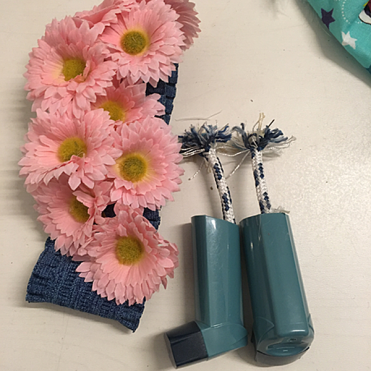 Inhaler and floral accessories at the Simon Cracker SS19 fashion show.