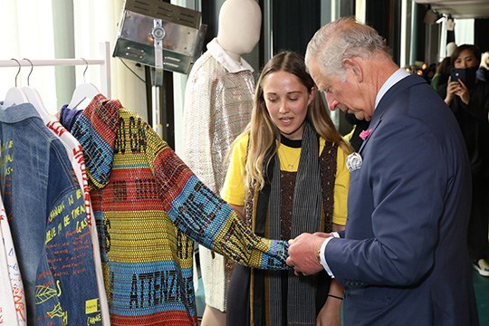 Charles, the Prince of Wales in the company of designer Bethany Williams, Mother of Pearl and Teatum Jones. (Photo by Darren Gerrish, British Fashion Council)