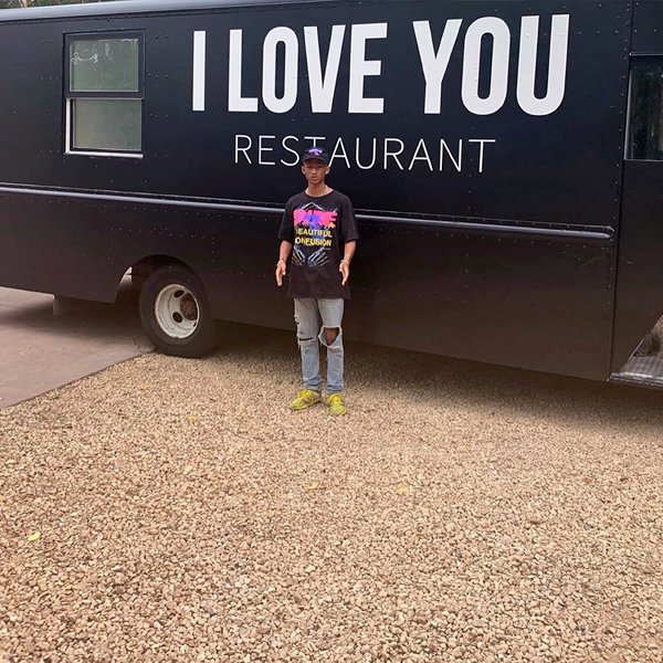 "Jaden Smith standing in front of the ""I Love You Restaurant"" food truck in downtown Los Angeles, July 2019. (photo: courtesy)"