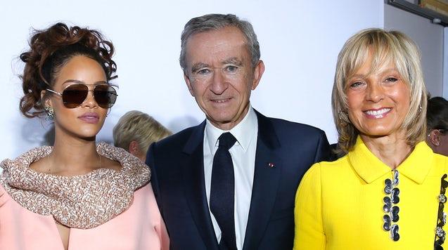 Rihanna with LVMH owner Bernard Arnault and his wife Helene Arnault. (Photo: Getty)
