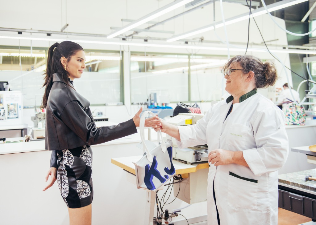 "Kendall Jenner at the Lonchamp Paris atelier custom designer her exclusive eco-sustainable ""Pliage"" tote bag (photo: Longchamp Paris)"