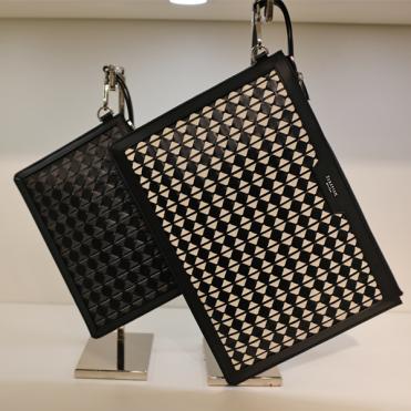 Serapian's luxurious hand-woven leather portfolio.