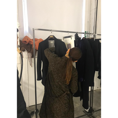 Assistant preparing for the Bed J. W. Ford fashion show during Milan Fashion Week. (photo: QC Humphrey)